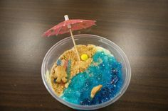 I made these for a luau party for my daughter. Use vanilla pudding and crushed graham crackers for sad, blue jello for water, add a sour strip towel and a sixlet beach ball for fun. Don't forget teddy grahams as people and an umbrella! The kids loved them!