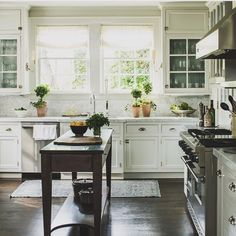 Things I love about this kitchen: the non-island island, the sconces on the sides of the cabinets framing the sink, classic white inset cabinets with glass fronts, the vintage style latch hardware on the uppers, that it could have been published 20 years ago and still look current. Classics never age. (Please share source if you know it. I saved it as a screen shot a couple weeks ago...) #nshinspiration
