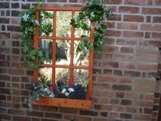 GARDEN SPACES: A window box with a difference. This window box comes complete with its own mirror window. Not only is it a novelty feature which will add interest and create a real talking point, it will also make your garden seem bigger than it is.