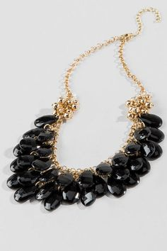 "The Manhattan Waterfall Necklace is a wardrobe must-have!  Golden & clear beads meet shimmering black faceted teardrops as they hang freely from a simple chain. This timeless piece is perfect for any party dress or for your office ensemble!<br />%0D%0A<br />%0D%0A- Finished with a lobster claw clasp<br />%0D%0A- 17.5"" length<br />%0D%0A- 3"" extension<br />%0D%0A- Lead & nickel free<br />%0D%0A- Imported<br />%0D%0A"