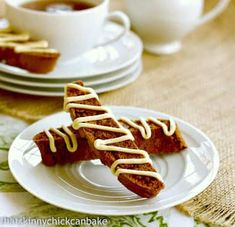 Today's Christmas Week theme is gingerbread surprise, so I veered off course and tried something new...gingerbread biscotti with a white chocolate drizzle. Perfect tea dipper for any of you ginger lovers.