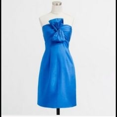 SALE! J.Crew Blue Bow Strapless Dress Beautiful JCrew blue strapless dress with bow detail at the bust. Built-in dress stays. Back zip and pockets. J. Crew Dresses Strapless
