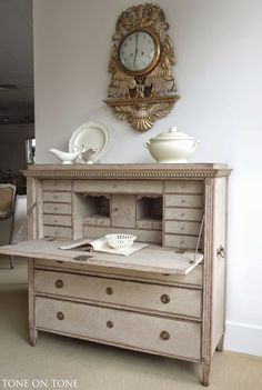 Swedish secretary with 25 drawers, niches & compartments. The top lifts for secret storage.  Tone on Tone