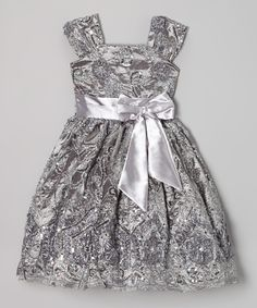 In this elegant dress, little princesses will make a splash at any fancy occasion. Regally adorned with a twirl-worthy skirt, satin sash and shimmering sequins, it's a frock fit for royalty.
