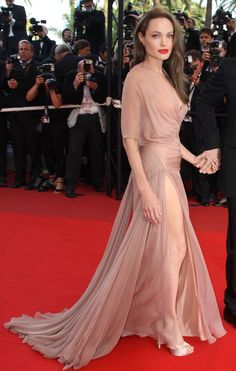 Nude Versace-Angelina Jolie//love love love this dress,so elegant....would also be pretty in white as a wedding dress....but sewn up,,,no slit for a wedding ..lol