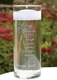 Remember those who can't be there on your wedding day with a personalized vase and floating candle.   Personalized In Loving Memory Cylinder   In Memory Wedding Ideas   Ways to Honor Deceased at Wedding   Ways to Remember Loved Ones   Memorial Wedding Ideas   #weddingideas #memorialweddingcandles #christianweddingcandles #floatingcandles
