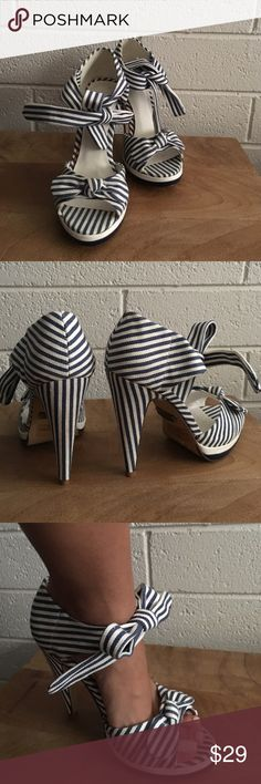 Peep toe blue and white stripe heel Peep toe blue and white stripe heel. Bow detail on the front of shoe. Pair with a white or black dress for the perfect look!   Never been worn!!  10% discount when you buy 2 or more items. Shoes Heels