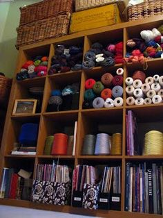 Gorgeous way to store yarn and bolts of fabric. I could use this as a hobby rack for my artwork, knitting, beading, scrapbooking, craft, puzzles and recipes all contained in one area.
