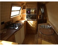 Nicely laid out kitchen area, nice looking wood - no orange pine in this narrowboat interior!
