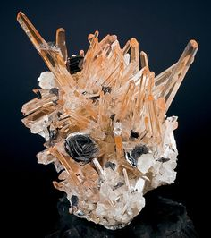 China is always producing great mineral specimens. I've never seen hematite and quartz look so good together!