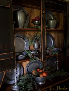 Dining room cupboard with pewter at Christmas
