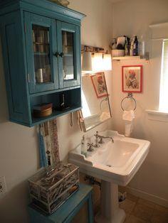 Bathroom- lighting, hardware, and mirror.