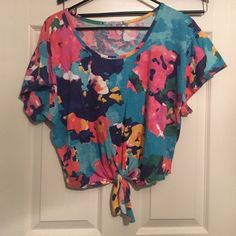 Charlotte Russe XL Floral Crop Top New Charlotte Russe XL Crop style shirt. Floral design with small tie in middle of front (bottom) stretchable and comfortable. Charlotte Russe Tops Crop Tops