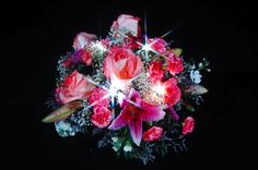 Pink Rose and Lily floral arrangement with White Sparkle Ribbon threaded through out.