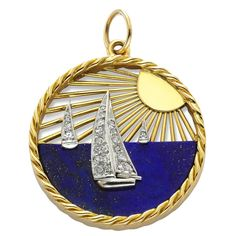 Van Cleef & Arpels: A Lapis Lazuli, Diamond and 18k Gold Charm, designed as a sailing scene at sunset, signed Van Cleef & Arpels, made in France, numbered 16V39, circa 1960.