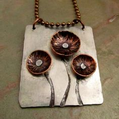 Mixed Metal Necklace with Copper Flowers - Riveted Cold Connections - Aluminum and Copper -  Regina Boger via Etsy.