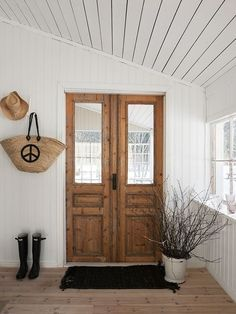 farmhouse french doors, but without the lights . . . would work in a cabin, too. (minus the Peace Basket on the wall)