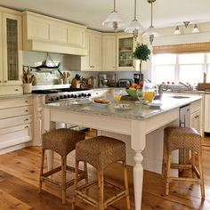 Gathering Spot- I love the stools!  A large, warm, family-style kitchen is perfect for a classic beach cottage. Use sunny accents and calming paint colors to create an inviting space.
