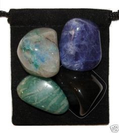 TRUTH REVEALED Tumbled Crystal Healing Set - 4 Gemstones w/Description & Pouch - Amazonite, Black Obsidian, Chrysocolla, and Sodalite. $4.99, via Etsy.
