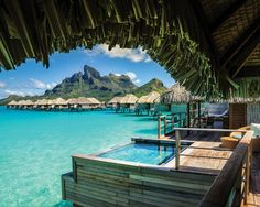 Take in stunning sunsets and panoramic views of the South Pacific, including the serene turquoise lagoon and majestic Mount Otemanu at the Four Seasons Resort Bora Bora. Book this for your next vacation to make that tropical island getaway a dream come true. | Photo Credit: Trey Ratcliff