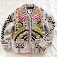love the color work in this antikbatik knitted baby sweater.