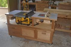 Table saw and router table idea to incorporate into the big workbench as movable end cap. Router Table Plans, Table Saw Workbench, Woodworking Bench Plans, Workbench Plans, Fine Woodworking, Woodworking Projects, Dewalt Table Saw Stand, Woodworking Apron, Youtube Woodworking