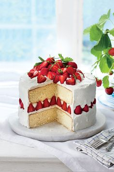 Strawberry Dream Cake - Luscious Layer Cakes - Southernliving. Recipe: Strawberry Dream Cake  You'll fall in love with this too-good-to-be-true strawberry cake. Fluffy whipped frosting made with marscapone cheese, sugar, whipping cream, and vanilla and almond extracts is the perfect finishing touch. We love the presentation of cake slices with upright strawberries between the layers. When it comes down to the details, this sweet confection takes the cake.