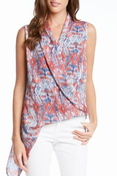 A colorful print gives free-spirited style to a sleeveless blouse with a flattering faux wrap bodice that releases into a dramatic asymmetric hem. Tank lining.    Length: 24 3/4 inches (size M)   Asymmetric Hem Tank by Karen Kane. Clothing - Tops - Sleeveless Clothing - Tops - Tees & Tanks Texas