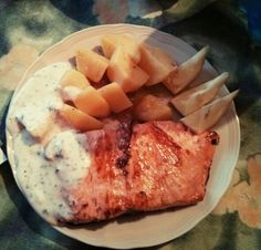 Salmon with garlic,lemon,wine and yogurt+mint sauce with baked potatoes