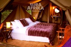 #PakulalaSafariCamp. 11 tents offering an elegant fusion of modern and classic accommodation, en suite bathrooms adorned with fresh flowers and crystal, blending elegant simplicity with a laid back style. Bathrooms contain hot shower with wooden deck and flush eco toilet.    #SuraAfrika luxury travels everywhere... #luxurysafaricamps #luxurytravels #Africa #comfort #safari