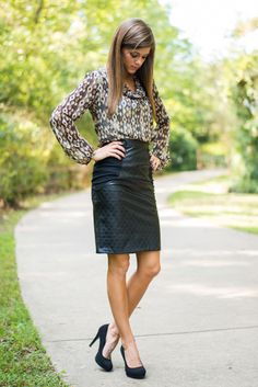 Free your mind from the stress of what to wear to work! This a-line skirt is just the thing for chic winter wear. The faux leather has such a fierce look and pairs amazingly with just about any blouse. Don't fret about the stiff material making you uncomfortable all day, the soft material on the sides have just the right amount of give for a stunning fit! :)   Material has no amount of stretch. Hidden zipper in the back. Miranda is wearing the small.