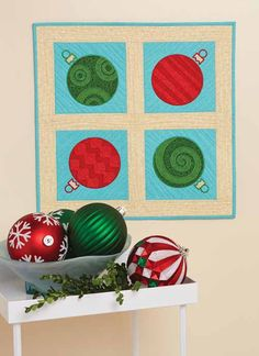 Cool Yule wall hanging by Patrick Lose.  Quilt kit at Fons and Porter.