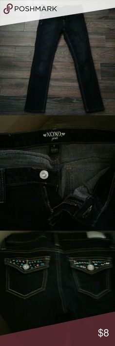 Kid jeans Skinny jeans with gems on the pockets all of the gems are still attached XOXO Bottoms Jeans