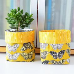 These bright butterfly plant pots are made with a gorgeous yellow linen fabric designed by @valoriwells! // Plant pots from sewandtellhandmade on Etsy