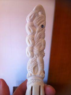 Maori Bone carving I made. It's a heru or hairpiece.
