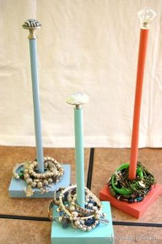 Use paper towel holders to hold bracelets... Looks a lot better then just having them piled on the bedside table or bathroom counter. Paint to get a pop of color and pick a beautiful topper to look like a piece of jewelry. by flora