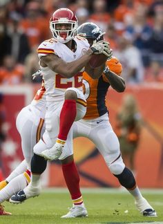 Kansas City Chiefs cornerback Marcus Peters intercepts a pass thrown by Peyton Manning intended for Denver Broncos wide receiver Emmanuel Sanders in the first quarter on Sunday, November 2015 at Sports Authority Field in Denver, Co. Kansas City Chiefs Football, Nfl Football Teams, Football Photos, Kansas City Royals, Denver Broncos, Football Season, American Sports, American Football, Justin Houston