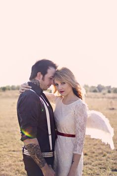 rock n roll bride photo, love the style, and that he is looking at her only, she at the camera