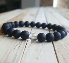 Check out this item in my Etsy shop https://www.etsy.com/listing/455528404/8mm-clear-quartz-bracelet-matte-matte