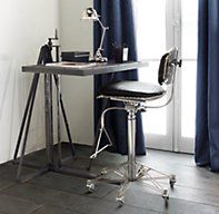 Restoration Hardware's 1940s Factory Work Table:A faithful reproduction of the tables used by assemblers in a French factory, circa 1940, our metal desk has a leather-clad top that adjusts for height.