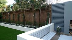 modern minimalist garden design low maintenance high impact garden design raised white wall beds grey decking east grass lawn turf sunken garden with fire and chimney flat trees balham wandsworth london (8)