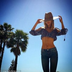 Wow thing: Flaunting her toned abs in jeans and a crop top, the pretty blonde has been get...