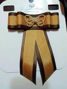 bow brooch café con dorado