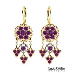 Sweetly shimmering these chandelier earrings are beautifully crafted in 24K Yellow Gold Plated over .925 Sterling Silver. The filigree ornaments that surrounds the purple Swarovski crystal flowers add just extra sparkle.  Measurements: Length: 45 mm = 1.77 in Width: 18 mm = 0.70 in Total item earrings weight: 7.6 grams = 0.27 oz Handmade in USA. This unique item comes to you in the original Lucia Costin gift boxes together with the guarantee card.