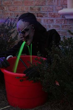 The vomiter.  The liquid is water with four highlighter wicks in the bucket.  Apply a blacklight.