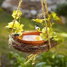 "Twig wreath and a terra cotta saucer ""Wing It: 16 Approaches to a DIY Birdbath"""