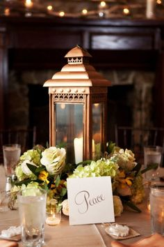 Copper lantern wedding centerpiece / http://www.deerpearlflowers.com/bronze-copper-wedding-color-ideas/2/