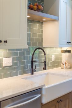 Lakehouse Renovation :: @Cambria Ella™ :: @The Tile Shop glass subway tile :: Custom Jkath Cabinetry.
