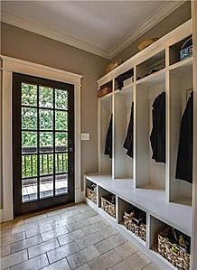 Mud room with open storage cubbies and full view door for light and to check weather.: