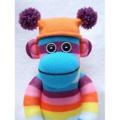 Easy way to learn how to make a sock monkey without a showing machine. Easy to follow directions by The Stitch Sharer.